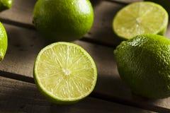 Raw Organic Green Limes Stock Photography