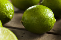 Raw Organic Green Limes Stock Images