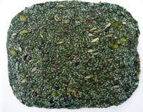 Raw organic green spirulina and seeds cursts Stock Photography