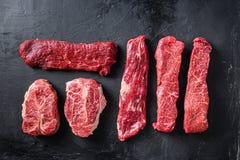 Raw organic meat Top Blade steaks near machete and denver steak, alternative beef cut or Australia wagyu oyster blade on black
