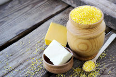 Raw organic polenta corn meal in a wooden bowl Royalty Free Stock Image