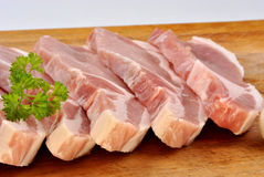Raw organic pork chop and parsley Royalty Free Stock Images