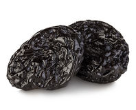 Raw organic prunes, dried plums, smoked prunes close-up on a white background. Stock Photos