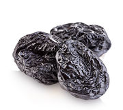 Raw organic prunes, dried plums, smoked prunes close-up on a white background. Royalty Free Stock Images