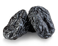 Raw organic prunes, dried plums, smoked prunes close-up on a white background. Stock Images