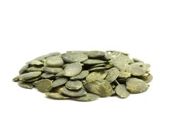 Raw Organic Pumpkin Seeds. Side view of raw organic pumkin seeds / kernels on white background stock photography