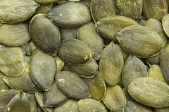 Raw Organic Pumpkin Seeds. Top view of raw organic pumkin seeds / kernels. Can be used as background royalty free stock image