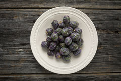 Raw Organic Purple Brussels Sprouts Stock Images