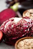 Raw organic purple radicchio lettuce. Violet cabbage with ingredients for cooking. Clean eating, vegan, vegetarian. Detox concept Stock Photography