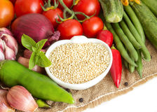Raw organic quinoa and vegetables Royalty Free Stock Images