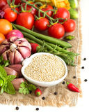 Raw organic quinoa and vegetables Stock Photo