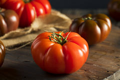 Raw Organic Red and Brown Heirloom Tomatoes Stock Images