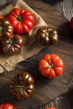 Raw Organic Red and Brown Heirloom Tomatoes Stock Image