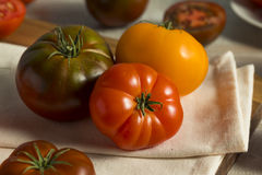 Raw Organic Red Heirloom Tomatoes royalty free stock photos