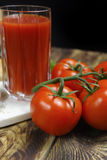 Raw Organic red Tomato Juice with salt, basil and bread Stock Photo