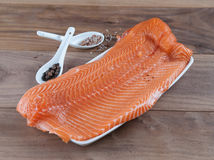 Raw Organic Salmon with Salt and Spices royalty free stock photography