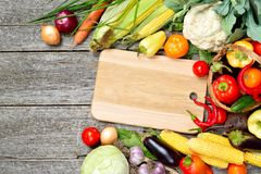 Raw organic set of fresh vegetables on a wood background. Autumn harvest from the garden Stock Images