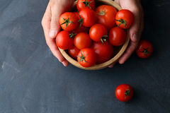Raw organic tomatoes in bowl Stock Image