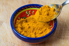 Raw organic turmeric spice powder. Royalty Free Stock Photos