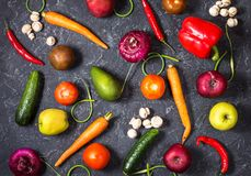 Raw organic vegetables with fresh ingredients for healthily cooking on vintage background, top view. Vegan or diet food concept Royalty Free Stock Photos