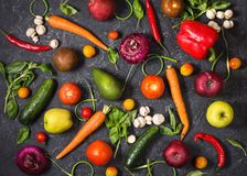Raw organic vegetables with fresh ingredients for healthily cooking on vintage background, top view. Vegan or diet food concept Royalty Free Stock Photo