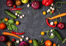 Raw organic vegetables with fresh ingredients for healthily cooking on vintage background, top view. Vegan or diet food. Concept. Copy space Stock Photos