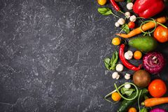 Raw organic vegetables with fresh ingredients for healthily cooking on vintage background, top view. Vegan or diet food. Concept. Copy space Royalty Free Stock Image