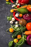 Raw organic vegetables with fresh ingredients for healthily cooking on vintage background. Vegan or diet food concept Stock Image