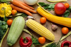 Raw organic vegetables with fresh ingredients for healthily cooking on wooden background, top view, banner. Vegan or. Diet food concept Stock Image