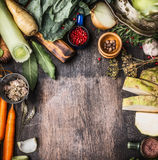 Raw organic vegetables ingredients for healthy cooking on rustic wooden background, top view, country food Stock Photos