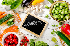Raw organic vegetables  on a wooden background. Top view. Diet eating concept Royalty Free Stock Photography