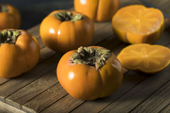 Raw Organic Yellow Persimmons Stock Photography