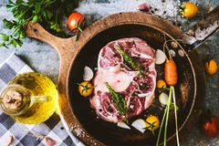 Raw osso buco. On rustic background Royalty Free Stock Images