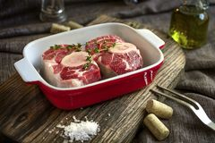 Raw Osso Buco steak in plate Royalty Free Stock Photos