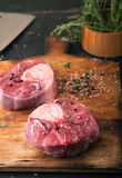 Raw ossobuco with spices Stock Image