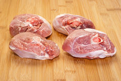 Raw ossobuco on wooden board. Ossobuco (bone-in lamb shank steaks) on a wooden chopping board Royalty Free Stock Photos