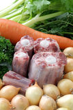 Raw oxtail and vegetables Royalty Free Stock Photos