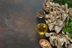 Raw oyster mushrooms. On a brown background Stock Photo