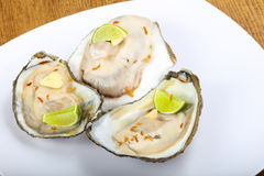 Raw oysters with lime Stock Photos