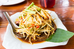 Raw papaya salad well known in thai is SOM-TAM. With banana leaf stock photo