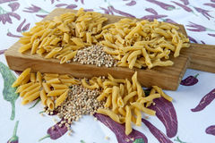 Raw pasta. Three types of pasta on a chopping board Royalty Free Stock Photography