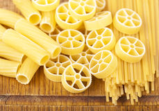Raw pasta. On wood background texture Stock Images