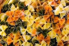 Raw Pasta. Italian tri-colored raw farfalle Stock Image