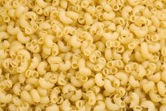 Raw pasta as background Royalty Free Stock Photography
