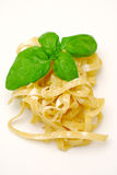 Raw pasta and basil Royalty Free Stock Photo