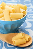 Raw pasta in a blue bowl Royalty Free Stock Images