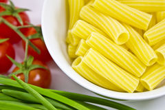 Raw pasta in a bowl Stock Image