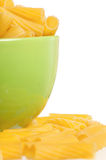 Raw pasta in bowl Stock Photos