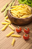 Raw pasta with cherry tomatoes Stock Images