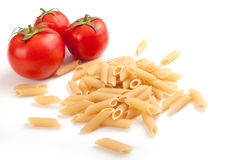 Raw Pasta. With cherry tomatoes with white space for your text here Royalty Free Stock Photo